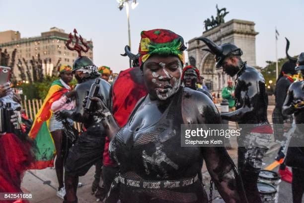 Revelers put motor oil on their skin while participating in a Caribbean street carnival called J'ouvert on September 4 2017 in the Brooklyn borough...