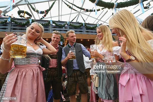 Revelers raise their beer glasses at the Schottenhamel beer tent on the opening day of the 2015 Oktoberfest on September 19 2015 in Munich Germany...