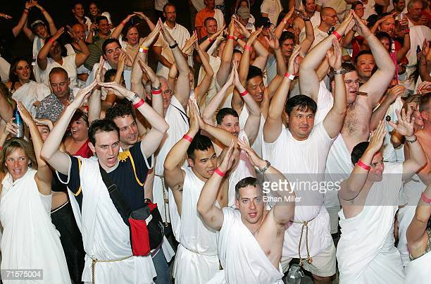 Revelers react at the Roman Plaza Amphitheater during a party to celebrate the 40th anniversary of Caesars Palace August 2 2006 in Las Vegas Nevada