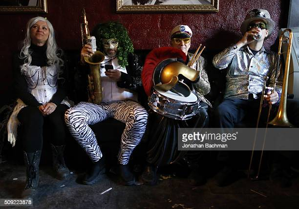 NEW ORLEANS LOUISIANA FEBRUARY 9 2016 Revelers rest in a bar during Mardi Gras day on February 9 2016 in New Orleans Louisiana Fat Tuesday or Mardi...