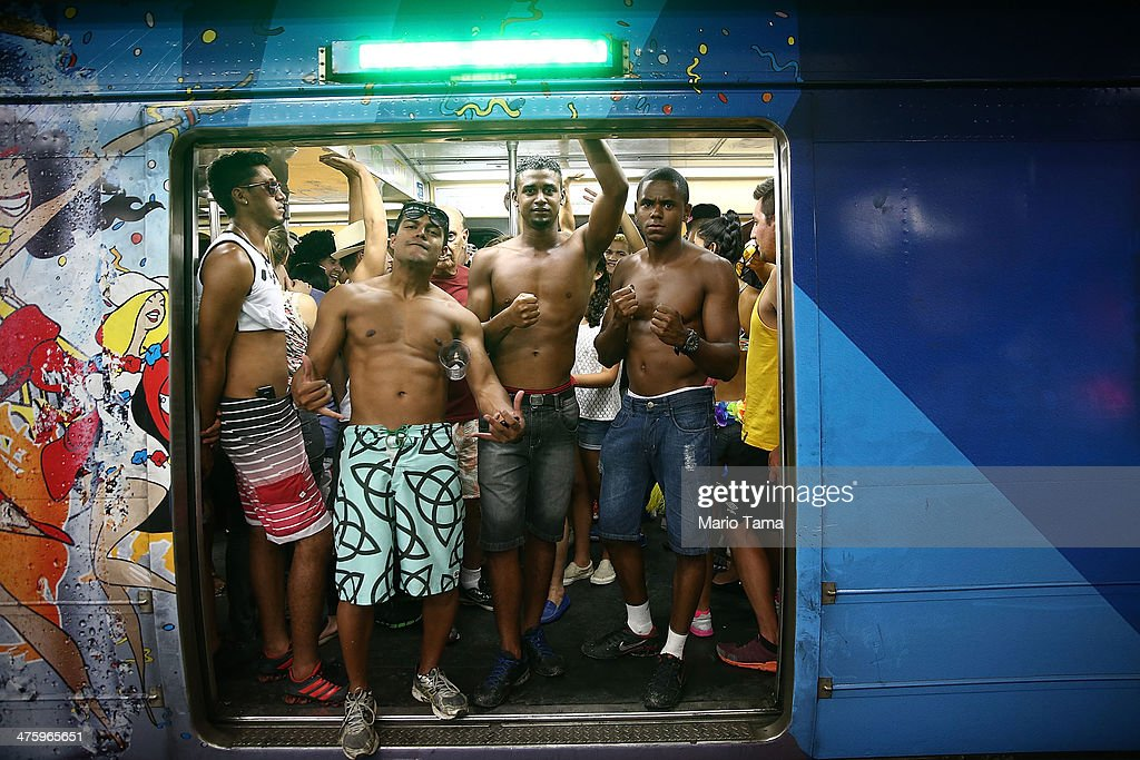 Revelers ride the subway before the 'Cordao do Bola Preta' street carnival bloco on March 1, 2014 in Rio de Janeiro, Brazil. Carnival is the grandest holiday in Brazil, annually drawing millions in raucous celebrations.