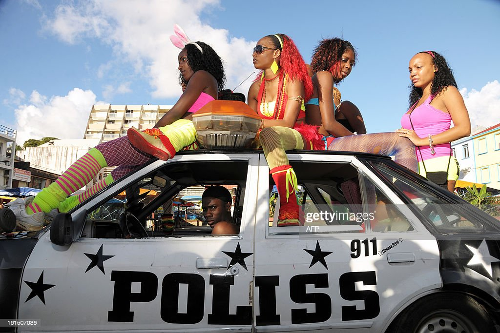 Revelers sit on the top of a car as they take part in the Carnival parade in the streets of Fort-de-France on the French Caribbean island of Martinique, on February 11, 2013. The Carnaval started on February 9, 2013 and will run until Ash Wednesday on February 13, 2013 when Vaval, a giant papier-mache figure symbolizing the king of the carnival, is burned.