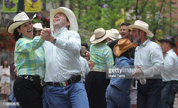 Revelers square dance during the Calgary Stampede on July 11 2011 in Calgary Alberta Canada The ten day event drawing over one million visitors is...