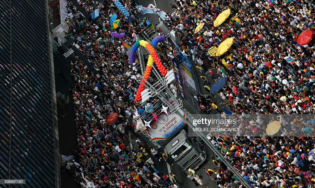 Revelers take part in the 20th Gay Pride Parade, whose theme is 'Gender identity law, NOW! Everyone together against transphobia!', in Sao Paulo, Brazil on May 29, 2016. / AFP / Miguel Schincariol