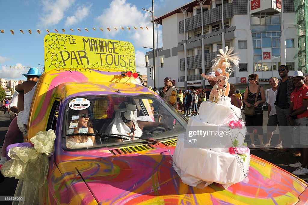 Revelers take part in the Carnival parade in the streets of Fort-de-France on the French Caribbean island of Martinique, on February 11, 2013. The Carnaval started on February 9, 2013 and will run until Ash Wednesday on February 13, 2013 when Vaval, a giant papier-mache figure symbolizing the king of the carnival, is burned.