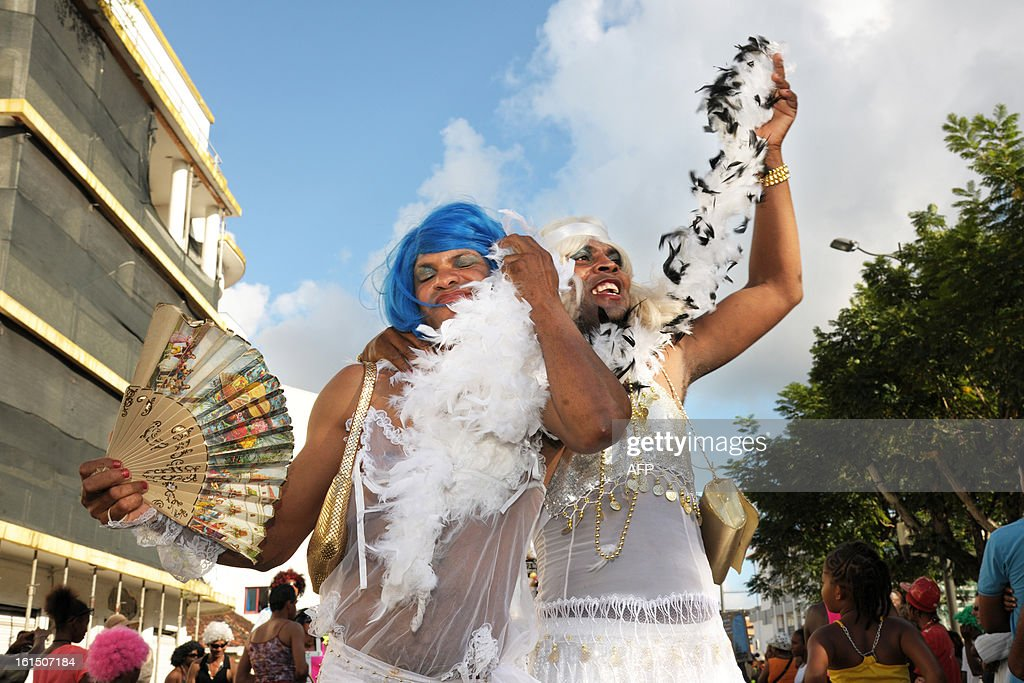 Revelers take part in the Carnival parade in the streets of Fort-de-France on the French Caribbean island of Martinique, on February 11, 2013. The Carnaval started on February 9, 2013 and will run until Ash Wednesday on February 13, 2013 when Vaval, a giant papier-mache figure symbolizing the king of the carnival, is burned. AFP PHOTO/ JEAN-MICHEL ANDRE