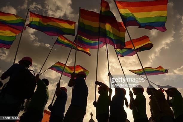 Revelers take part in the Gay Pride Parade in San Salvador El Salvador on June 27 2015 AFP PHOTO/ Marvin RECINOS