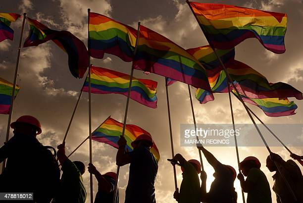 Revelers take part in the Gay Pride Parade in San Salvador El Salvador on June 27 2015 AFP PHOTO/ Marvin RECINOS