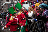 Revelers take photos with crowd members during the Macy's Thanksgiving Day Parade on November 27 2014 in New York City Over 8000 people took part in...