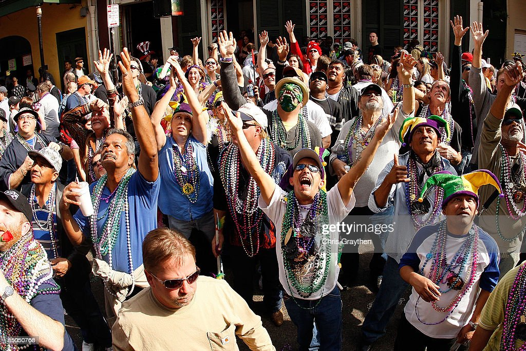 Revelers wait for beads to fall from a balcony on Bourbon Street during Mardi Gras on February 24 2009 in New Orleans LouisianaThe Mardi Gras...