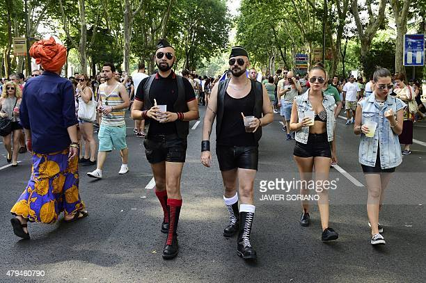 Revelers walk during the annual Gay Pride Parade in Madrid on July 4 2015 AFP PHOTO/ JAVIER SORIANO
