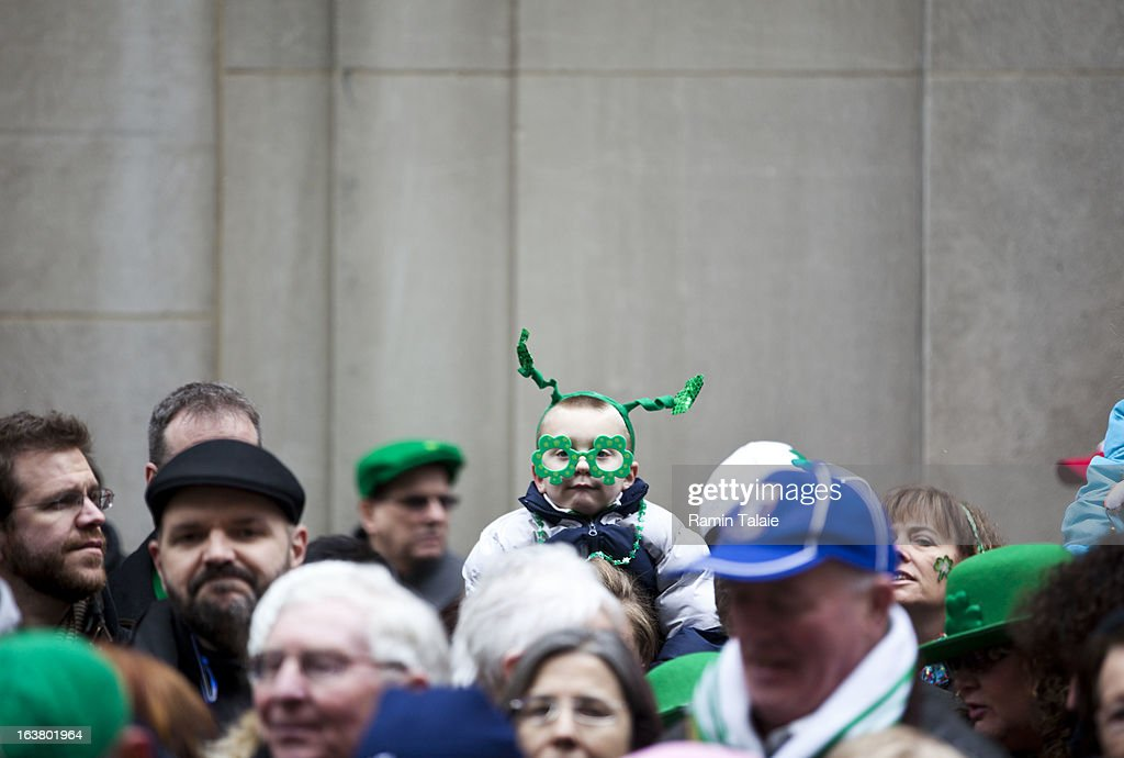 Revelers watch the 252nd annual St. Patrick's Day Parade March 16, 2013 in New York City. The parade honors the patron saint of Ireland and was held for the first time in New York on March 17, 1762, 14 years before the signing of the Declaration of Independence.