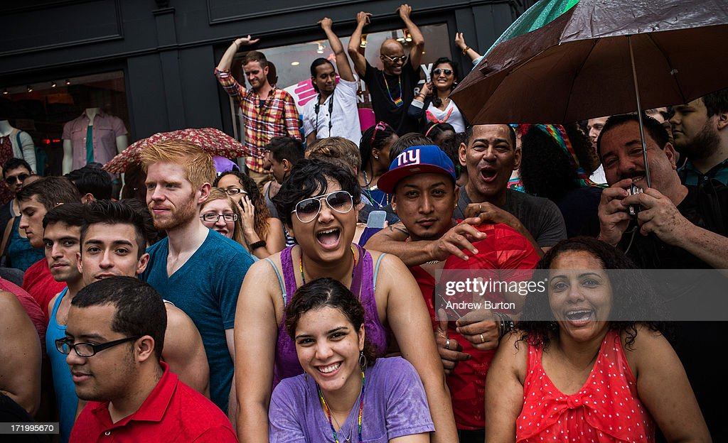 Revelers watch the New York Gay Pride Parade on June 30, 2013 in New York City. This year's parade was a particularly festive occasion, due to the recent Supreme Court Ruling that it was unconstitutional to ban gay marriage.