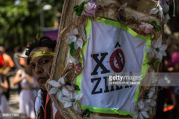 Revelers wearing Greek style costumes raise awareness of the need to prevent the spread of the Zika virus in the first carnival ''Bloco'' under the...