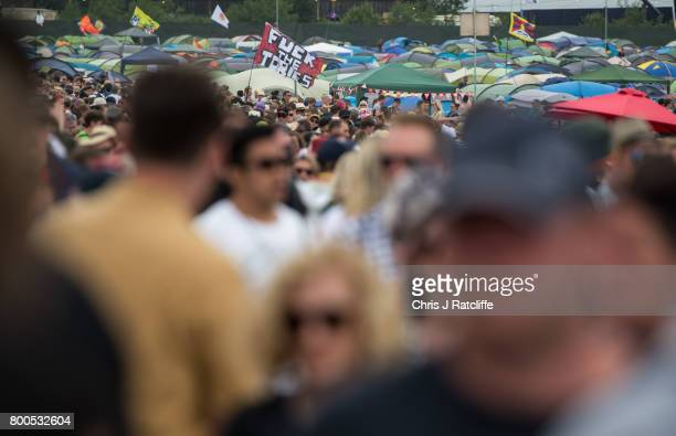 A reveller carries a 'Fuck the Tories' flag past the Other Stage at Glastonbury Festival Site on June 24 2017 in Glastonbury England Labour Party...