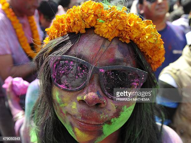 A reveller celebrates the Holi spring festival in Kathmandu on March 16 2014 The 'Holi' festival of colours is a riotous celebration of the coming of...