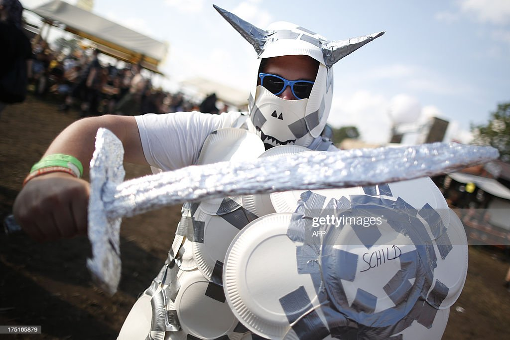 A Reveller clad in armor composed of paper plates poses during the 24th heavy metal Wacken Open Air (WOA) Festival 2013 in Wacken, northern Germany on August 1, 2013. With some 80,000 festival visitors it attracts all kinds of metal music fans, such as fans of black metal, death metal, power metal, thrash metal, gothic metal, folk metal and even metalcore, nu metal and hard rock from around the world.