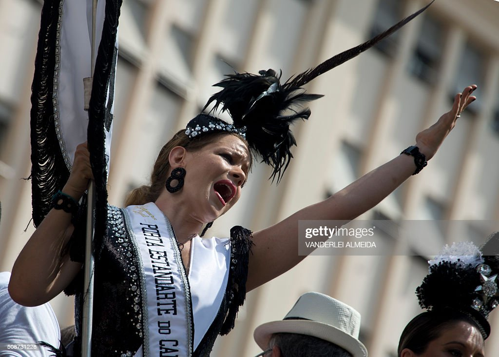 A reveller dances during the traditional 'Cordao do Bola Preta' carnival band parade, in downtown Rio de Janeiro, Brazil, on February 6, 2016. Though Brazil's carnival will reach a fever pitch Sunday with Rio's flamboyant float competition, Brazilians have already started banging drums, dancing and singing in the sultry streets of Rio and across the country before the official start of what Brazilians dub 'The Greatest Show on Earth. AFP PHOTO / VANDERLEI ALMEIDA / AFP / VANDERLEI ALMEIDA
