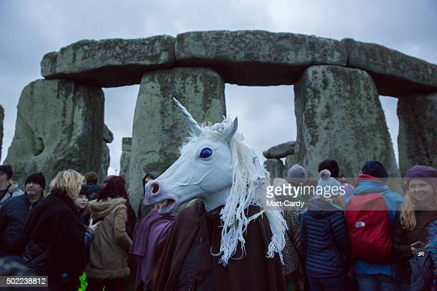 A reveller dressed as a unicorn walks outside the stones as druids pagans and revellers gather in the centre of Stonehenge hoping to see the sun rise...