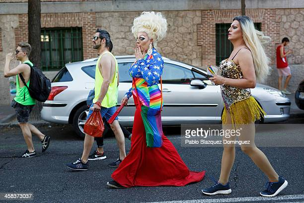 A reveller dressed with the raimbow or gay pride flag walks the street before the Pride Parade during the Madrid Gay Pride Festival on June 29 2016...