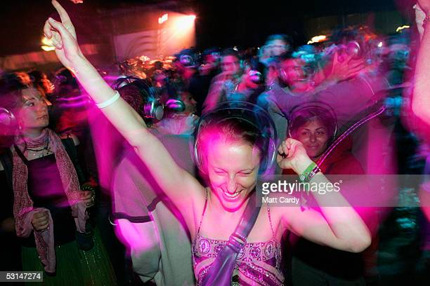 A reveller enjoys the silent allnight disco in the Dance Tent on the second day of the Glastonbury Music Festival 2005 at Worthy Farm Pilton on June...