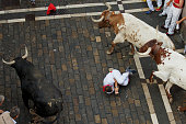 A reveller falls while running with Jandilla's fighting bulls along the Calle Estafeta during the second day of the San Fermin Running Of The Bulls...