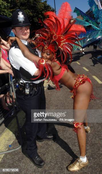 A reveller from Trinidad dances with a reluctant policeman at the Notting Hill Carnival in west London Monday August 29 2005 The streets of Notting...