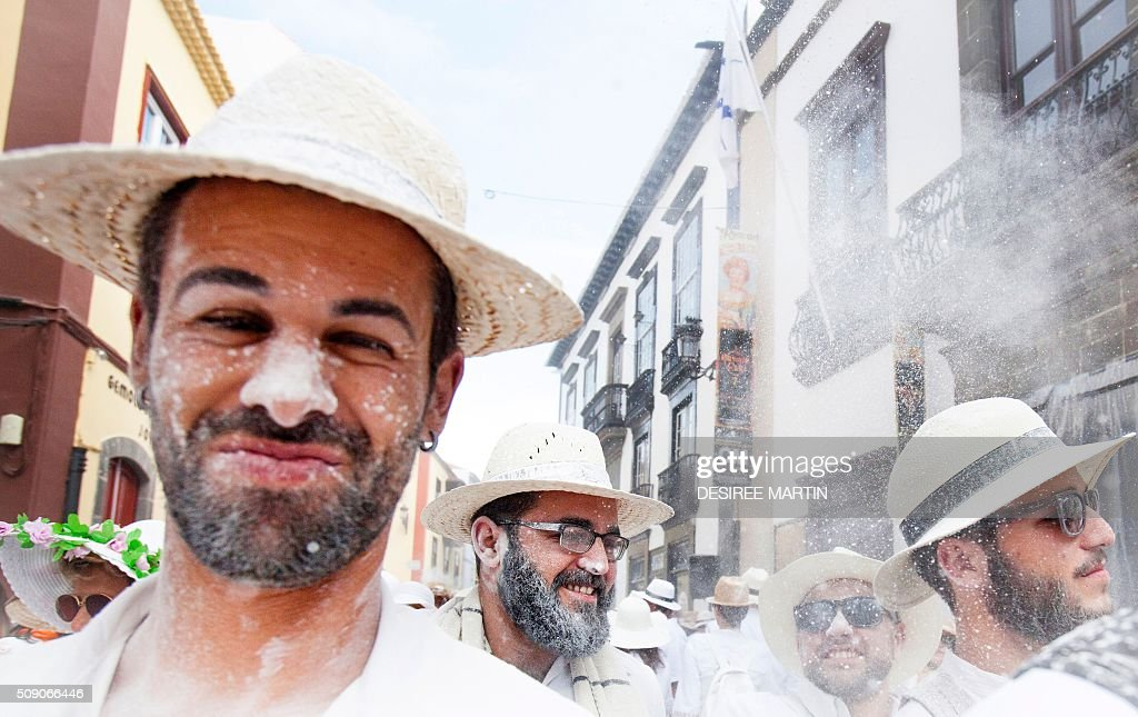 A reveller grimaces during the street carnival 'Los Indianos' in Santa Cruz de la Palma, on the Spanish Canary island of La Palma, on February 8, 2016. The over one-month-long including 'Los Indianos sees orchestras playing Caribbean and Brazilian rhythms throughout the festivities that range from elections for the Carnival Queen, the Junior Queen and the Senior Queen, children and adult murgas (satirical street bands), comparsas (dance groups) to performances on the streets. AFP PHOTO / DESIREE MARTIN / AFP / DESIREE MARTIN