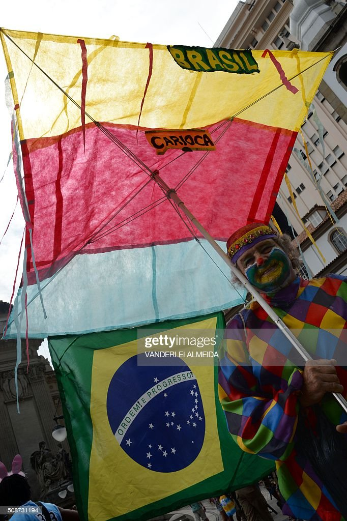 A reveller has fun during the traditional 'Cordao do Bola Preta' carnival band parade, in downtown Rio de Janeiro, Brazil, on February 6, 2016. Though Brazil's carnival will reach a fever pitch Sunday with Rio's flamboyant float competition, Brazilians have already started banging drums, dancing and singing in the sultry streets of Rio and across the country before the official start of what Brazilians dub 'The Greatest Show on Earth. AFP PHOTO / VANDERLEI ALMEIDA / AFP / VANDERLEI ALMEIDA