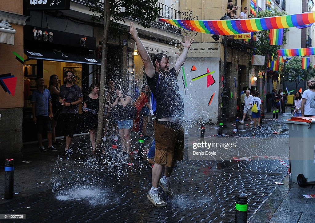 A reveller has water thrown on him from a balcony during the 2016 Madrid Gay Pride week on June 30, 2016 in Madrid, Spain. Hundreds of thousands of revellers celebrate the Gay Pride week in Madrid, one of the biggest in Europe.