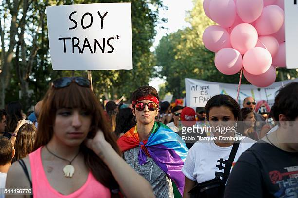 A reveller holds a placard reading 'I am trans' during the Madrid Gay Pride Parade on July 02 2016 in Madrid Spain Madrid Gay Pride Festival is one...
