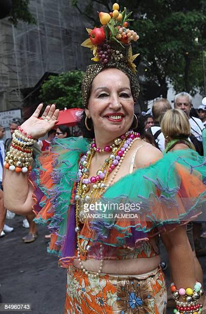 A reveller in 'Carmen Miranda' costume takes party in the traditional 'Cordao da Bola Preta' carnival band parade along Rio Branco avenue in downtown...