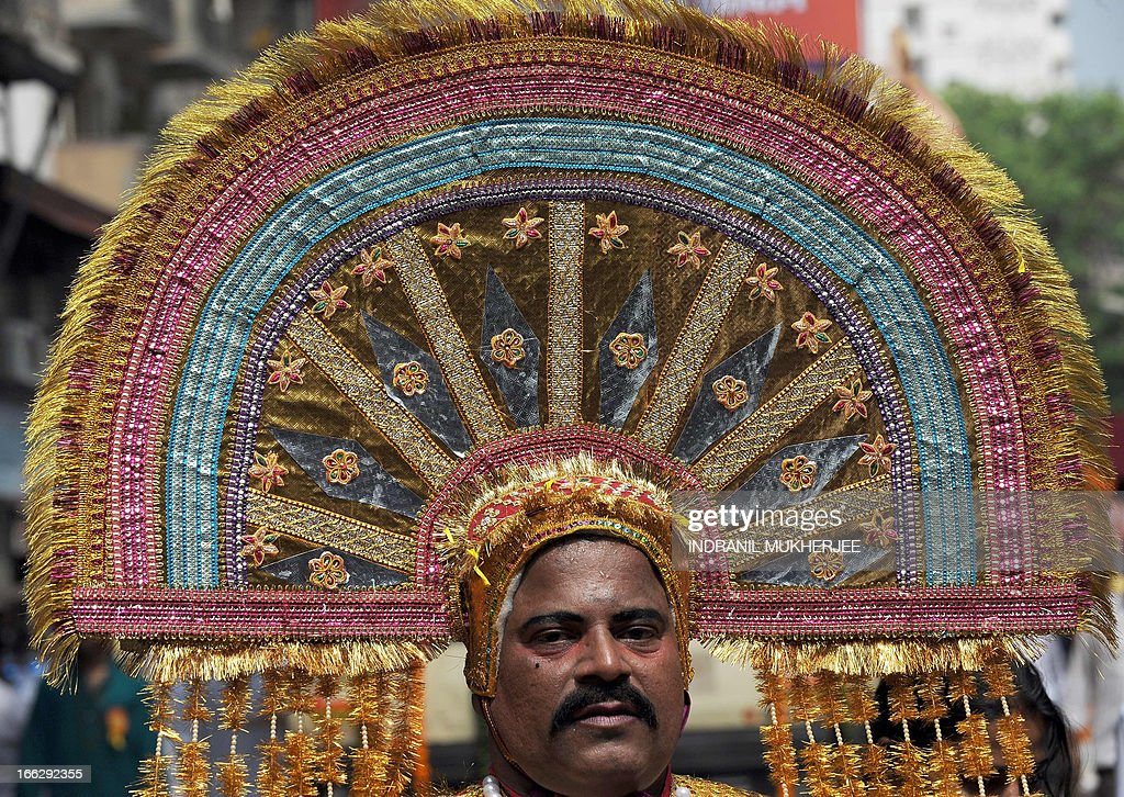 A reveller is pictured with ornamental headgear during a procession celebrating 'Gudi Padwa' or the Maharashtrian new year in Mumbai on April 11, 2013. Gudi Padwa is the Hindu new year for the people of India's state of Maharashtra, that falls on the first day of the month of Chaitra according to the lunar calendar and is celebrated by dancing and singing. Gudi Padwa also marks the end of the harvest and the beginning of the new season. AFP PHOTO/ INDRANIL MUKHERJEE