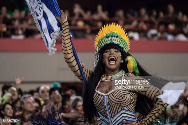 A reveller of BeijaFlor performs during the first night of Rio's Carnival at the Sambadrome in Rio de Janeiro Brazil early on February 27 2017 / AFP...