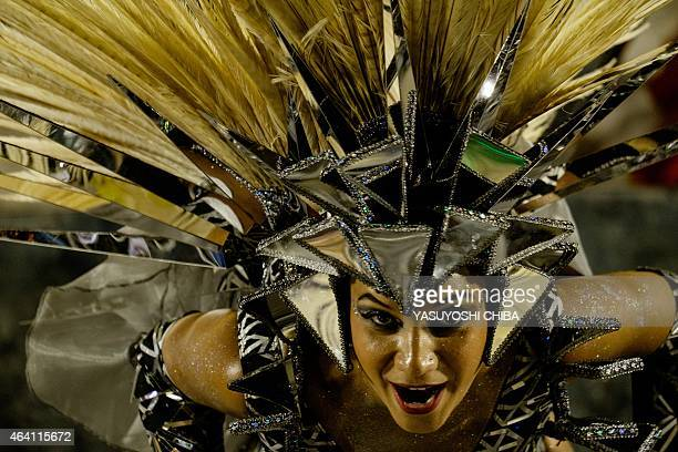 A reveller of BeijaFlor Samba School the champion of the 2015 Rio's Carnival performs during the Champions' Parade at the Sambadrome in Rio Brazil on...