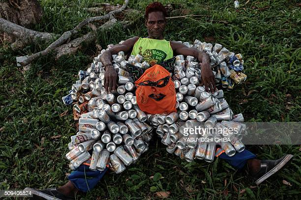 A reveller of Bloco da Latinha a street carnival group takes a rest during a parade on the last day of carnival in Madre de Deus Bahia State Brazil...