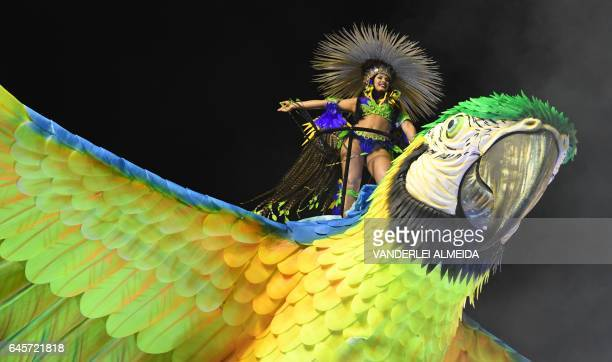 A reveller of the Imperatriz Leopoldinense samba school performs during the first night of Rio's Carnival at the Sambadrome in Rio de Janeiro Brazil...
