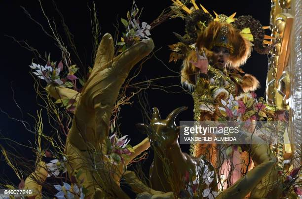 A reveller of the Mocidade Independente de Padre Miguel samba school performs during the second night of Rio's Carnival at the Sambadrome in Rio de...