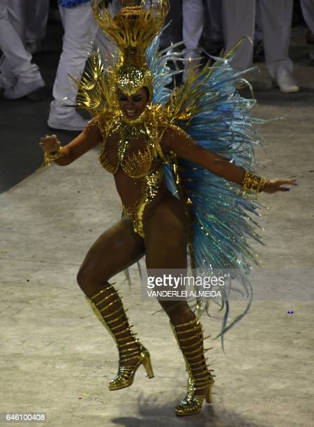 A reveller of the Portela samba school performs on the second night of Rio's Carnival at the Sambadrome in Rio de Janeiro Brazil early on February 28...