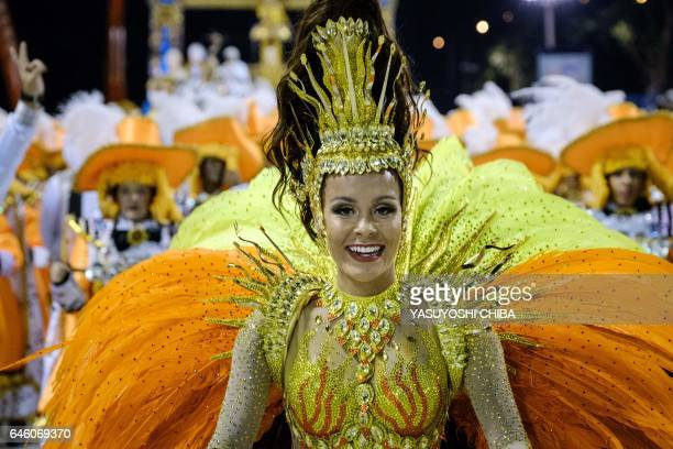 A reveller of the Sao Clemente samba school performs during the second night of Rio's Carnival at the Sambadrome in Rio de Janeiro Brazil on February...