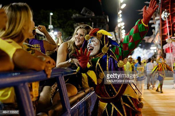 A reveller of Unidos da Tijuca Samba School 4th in the 2015 Rio's Carnival performs during the Champions' Parade at the Sambadrome in Rio Brazil on...