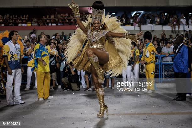 A reveller of Unidos da Tijuca samba school performs on the second night of Rio's Carnival at the Sambadrome in Rio de Janeiro Brazil early on...