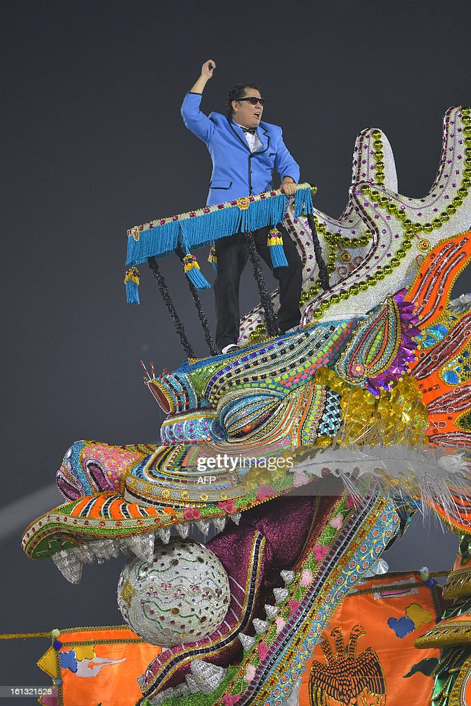 A reveller of Unidos de Vila Maria samba school disguised as South Korean singer Psy, perform honoring Korean inmigration in Brazil, during the second night of carnival parade at the Sambadrome in Sao Paulo,Brazil, on February 10, 2013.