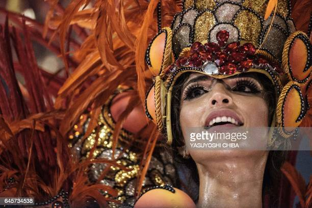 A reveller performs with the Grande Rio samba school during the first night of Rio's Carnival at the Sambadrome in Rio de Janeiro Brazil early on...