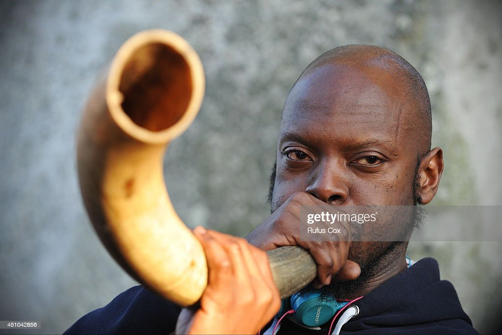 A reveller plays a horn while taking part in celebrations to mark the summer solstice at Stonehenge prehistoric monument on June 21, 2014 in Wiltshire, England. An estimated 37,000 revellers and modern day druids gathered at Stonehenge, a tradition dating back thousands of years, to celebrate the solstice and watch the sunrise.