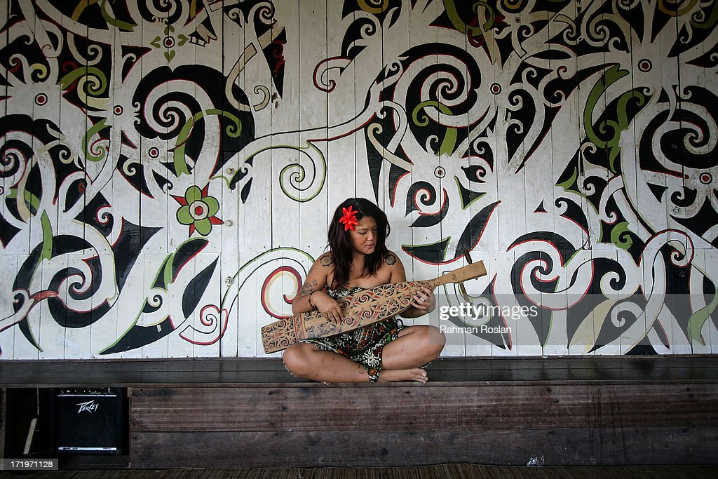 A reveller plays a traditional musical instrument called Sape during the Rainforest World Music Festival on June 30, 2013 in Kuching, Sarawak, Malaysia. The Rainforest World Music Festival was recognized as one of the 25 Best International Festivals by renowned world music magazine, Songlines, draws thousands of revelers every year from all over the world.