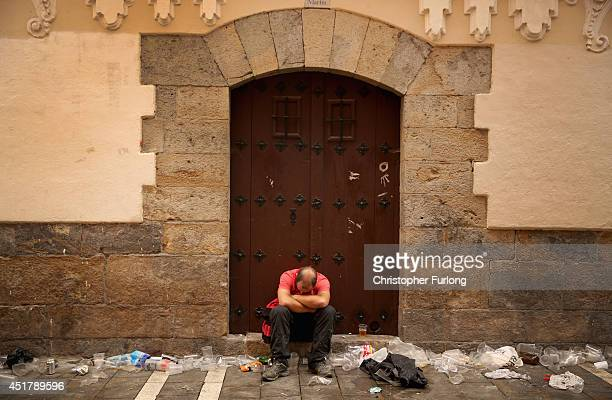 A reveller sleeps off the effects of the night before during the second day of the San Fermin Running Of The Bulls festival on July 7 2014 in...