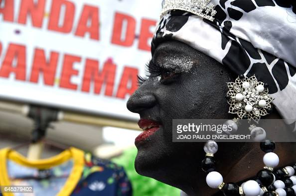 A reveller takes part in the 'Banda de Ipanema' traditional carnival band parade in the beach of Ipanema in Rio de Janeiro Brazil on February 25 2017...