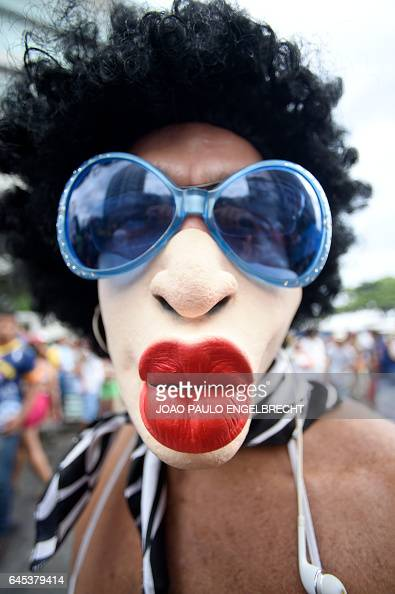TOPSHOT A reveller takes part in the 'Banda de Ipanema' traditional carnival band parade in the beach of Ipanema in Rio de Janeiro Brazil on February...