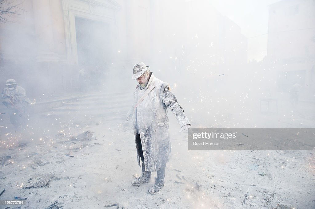 A Reveller takes part in the battle of 'Enfarinats', a flour fight in celebration of the Els Enfarinats festival on December 28, 2012 in Ibi, Spain. Citizens of Ibi annually celebrate the festival with a battle using flour, eggs and firecrackers. The battle takes place between two groups, a group of married men called 'Els Enfarinats' which take the control of the village for one day pronouncing a whole of ridiculous laws and fining the citizens that infringe them and a group called 'La Oposicio' which try to restore order. At the end of the day the money collected from the fines is donated to charitable causes in the village. The festival has been celebrated since 1981 after the town of Ibi recovered the tradition but the origins remain unknown.